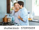 smiling woman letting man taste ... | Shutterstock . vector #570995059
