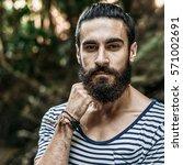 portrait of a brutal bearded... | Shutterstock . vector #571002691
