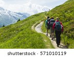 Group Of Hikers Follow A Trail...