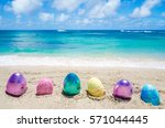 easter color eggs on the sandy... | Shutterstock . vector #571044445