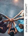 top view shot of stack of hands.... | Shutterstock . vector #571054477