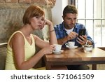 young american couple at coffee ... | Shutterstock . vector #571061509