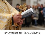 Priest Hand That Holds The...