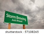 Storm Brewing Just Ahead Green Road Sign with Dramatic Storm Clouds and Sky. - stock photo