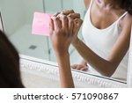 Reflection Of Woman Sticking I...