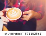 coffee latte art on woman hand... | Shutterstock . vector #571102561