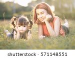 young mother and daughter... | Shutterstock . vector #571148551