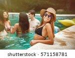happy young girls in pool | Shutterstock . vector #571158781