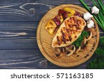 top view of grilled chicken... | Shutterstock . vector #571163185