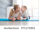 fitness mother with her 9 years ... | Shutterstock . vector #571173301