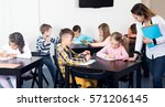 young professor and elementary... | Shutterstock . vector #571206145