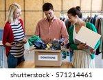 colleagues using digital tablet ... | Shutterstock . vector #571214461