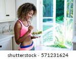 happy woman having bowl of... | Shutterstock . vector #571231624