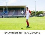 athlete juggling the football... | Shutterstock . vector #571239241