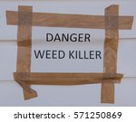 """Small photo of """"Danger Weed Killer"""" Sign in the Town of Burnham on Crouch on the Estuary of the River Crouch in Essex, England, UK."""