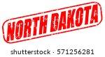 north dakota red stamp on white ...   Shutterstock . vector #571256281