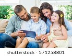 parents and kids using digital... | Shutterstock . vector #571258801