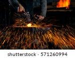 The Blacksmith Manually Forgin...