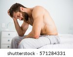 Depressed Man On Bed With Hand...