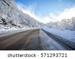 mountain road in a sunny day ... | Shutterstock . vector #571293721