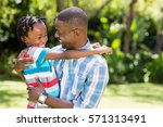 happy family posing together at ... | Shutterstock . vector #571313491