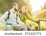 young couple having a break... | Shutterstock . vector #571321771