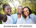 happy family posing together at ... | Shutterstock . vector #571324261