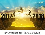 girls jump to the new year 2018 ... | Shutterstock . vector #571334335