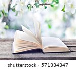 open book on wooden table... | Shutterstock . vector #571334347