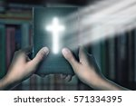 magic bible book with magic... | Shutterstock . vector #571334395