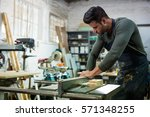 carpenter working on his craft... | Shutterstock . vector #571348255