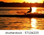 Water Skier Silhouetted By...