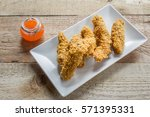 crispy chicken strips on... | Shutterstock . vector #571395331