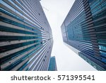 looking up at business buildings | Shutterstock . vector #571395541