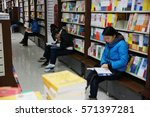Small photo of NANCHANG CHINA-December 14, 2012:several parents use the weekend to accompany their children to read books in the bookstore.