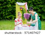 mother with daughter | Shutterstock . vector #571407427