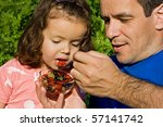 father giving fresh fruits to... | Shutterstock . vector #57141742