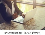 young woman using laptop in the ... | Shutterstock . vector #571419994