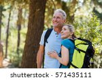 couple looking something and... | Shutterstock . vector #571435111