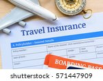 Small photo of Travel insurance form put on a wood table. Many agent sells airplane tickets or travel packages allow consumers to purchase travel insurance also known as travelers insurance as an added service.
