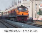 blur yellow diesel train | Shutterstock . vector #571451881