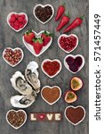 Small photo of Aphrodisiac food with foods in heart shaped bowls and loose on marble background.