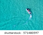 people are playing a jet ski in ... | Shutterstock . vector #571480597