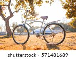 a vintage bicycle in a... | Shutterstock . vector #571481689