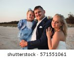 happy family watching the... | Shutterstock . vector #571551061
