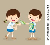student boy give a book to... | Shutterstock .eps vector #571586755