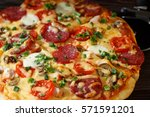 homemade pizza on a rustic table | Shutterstock . vector #571591201