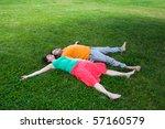 happy couple lying in grass...   Shutterstock . vector #57160579