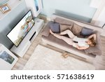 high angle view of woman lying... | Shutterstock . vector #571638619