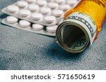 rolled money bills in orange... | Shutterstock . vector #571650619